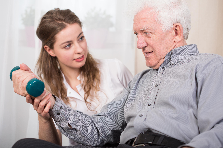 Therapist with Elderly Patient